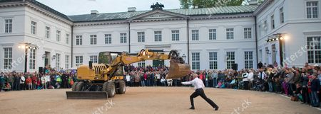 A Picture Made Available on 19 May 2013 Shows Dancer Philippe Priasso From France Dancing a 'Pas De Deux' with an Excavator During the Neuhardenberg Night in Neuhardenberg Germany 18 May 2013 Several Thousands of Visitors Attended the Event That Also Included Music Performances Light Installations and a Firework Display Germany Neuhardenberg