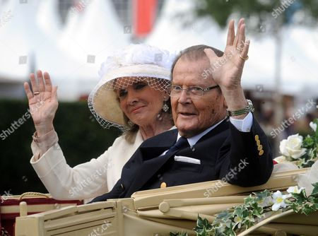 British Actor Roger Moore (r) and His Danish Wife Kristina Tholstrup Arrive in a Horse Drawn Carriage For the Opening of the International Horse Show Chio in Aachen Germany 25 June 2013 Denmark is This Year's Partner Country at the Chio Aachen Which Runs Until 30 June Germany Aachen