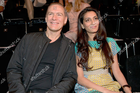 Megha Mittal (r) Chairwoman and Managing Director of the German Fashion Luxury Brand Escada and Escada Chief Bruno Saelzer Attend the Escada Sport Show During the Mercedes-benz Fashion Week in Berlin Germany 04 July 2012 the Presentation of the Spring/summer 2013 Collections Takes Place From From 04 to 07 July 2012 Germany Berlin