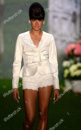 Model Lovelyn Enebechi Presents a Creation From the Spring-summer 2014 Collection by Austrian Designer Lena Hoschek During the Mercedes-benz Fashion Week in Berlin Germany 02 July 2013 the Presentations Will Take Place From 02 to 05 July Germany Berlin