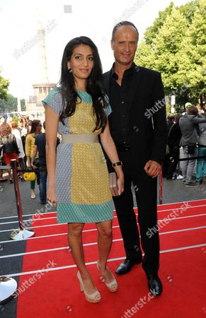 Stock Photo of Megha Mittal (l) Chairwoman and Managing Director of the German Fashion Luxury Brand Escada and Escada Chief Bruno Saelzer Attend the Escada Sport Show During the Mercedes-benz Fashion Week in Berlin Germany 04 July 2012 the Presentation of the Spring/summer 2013 Collections Takes Place From From 04 to 07 July 2012 Germany Berlin
