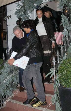 Boris Becker's son Noah Gabriel carrying a box and Sharlely Lilly Kerssenberg