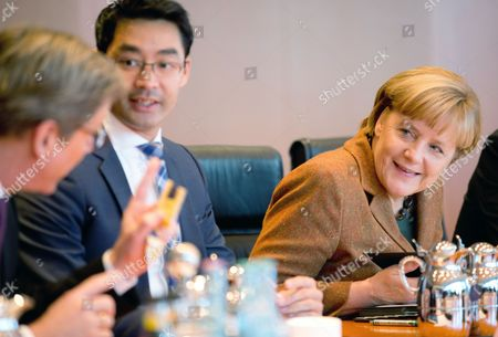 German Chancellor Angela Merkel (r-l) Talks with Departing Economics Minister Philipp Roesler and Foreign Minister Guido Westerwelle Before a Meeting of the German Cabinet at the Federal Chancellery in Berlin Germany 16 October 2013 Germany's Green Party Abandoned Coalition Talks with Chancellor Angela Merkel Early on 16 October 2013 After the Two Sides Failed to Substantially Bridge Their Policy Differences Germany Berlin