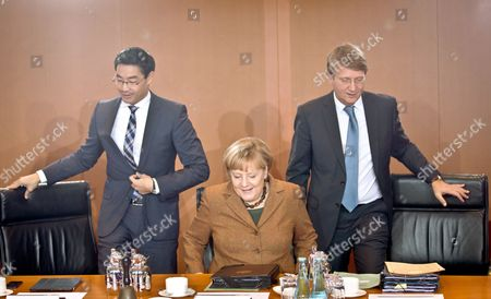 German Chancellor Angela Merkel Sits Between Economics Minister Philipp Roesler (l) and Chief of Staff Ronald Pofalla (r) Before a Meeting of the German Cabinet at the Federal Chancellery in Berlin Germany 16 October 2013 Germany's Green Party Abandoned Coalition Talks with Chancellor Angela Merkel Early on 16 October 2013 After the Two Sides Failed to Substantially Bridge Their Policy Differences Germany Berlin