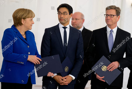 Germanáchancellor Angela Merkel (r-l) Economics Minister Philipp Roesler Andáforeign Minister Guido Westerwelle Attend a Ceremony For Receiving Certificates of Discharge at Bellevue Palace in Berlin Germany 22 October 2013 the Current German Government Will Remain in Power Until a New Coalition is Formed Germany Berlin