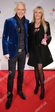 H P Baxxter of Techno Group Scooter with Girlfriend Nikola Jancso Arrives at the 'Musik Hilft' Charity Dinner at Grill Royal in Berlin Germany 20 March 2013 As Per Tradition Artists Gather Together For the Charity Event on the Eve of the German Echo Music Awards Germany Berlin