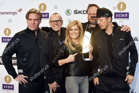 German Singer Helene Fischer Poses with Members of the German Band 'Die Fantastischen Vier' (l-r) Andreas Rieke Aka and Ypsilon Thomas Duerr Aka Thomas D Bernd Schmidt Aka Smudo and Michael Beck During a Press Session For the 2014 Echo Awards Ináberlin ágermany 26 March 2014 Fischer is the Presentor of the 23rd Echo Music Awards Which Will Take Place on 27 March Germany Berlin