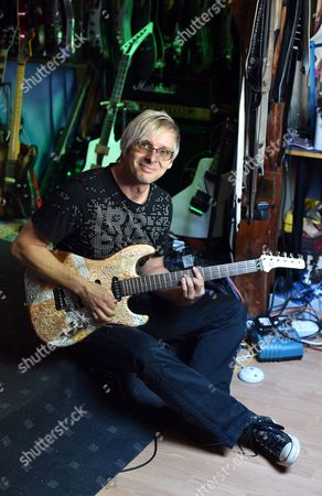 Music Producer Guitar Designer and Owner of Mspáguitars Martin Schlechta Poses in His Music Studio in Berlin Germany 08áaugust 2014 He Designs Unusual Electric Guitars Which Use His Own Design For Pick-ups and Other Electronics That Give Them a Special Sound He Designs All of the Guitars Individually with Special Surfaces Made From Leather Rhinestones Or Brass Inlays He Cooperates with Sido Marcia Barrett and Jennifer Rush Germany Berlin