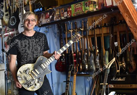 Stock Photo of Music Producer Guitar Designer and Owner of Mspáguitars Martin Schlechta Poses in His Music Studio in Berlin Germany 08áaugust 2014 He Designs Unusual Electric Guitars Which Use His Own Design For Pick-ups and Other Electronics That Give Them a Special Sound He Designs All of the Guitars Individually with Special Surfaces Made From Leather Rhinestones Or Brass Inlays He Cooperates with Sido Marcia Barrett and Jennifer Rush Germany Berlin
