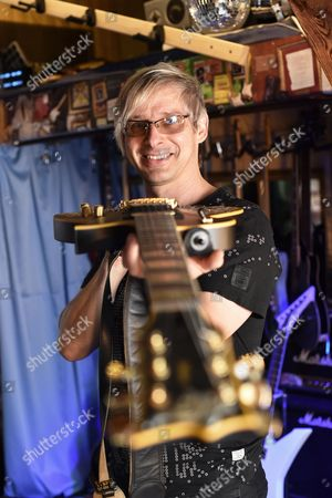 Stock Picture of Music Producer Guitar Designer and Owner of Mspáguitars Martin Schlechta Poses in His Music Studio in Berlin Germany 08áaugust 2014 He Designs Unusual Electric Guitars Which Use His Own Design For Pick-ups and Other Electronics That Give Them a Special Sound He Designs All of the Guitars Individually with Special Surfaces Made From Leather Rhinestones Or Brass Inlays He Cooperates with Sido Marcia Barrett and Jennifer Rush Germany Berlin