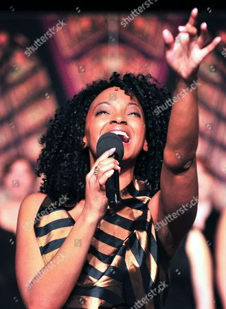 Stock Photo of Zodwa Selele Lead Actress in the Musical 'Sister Act' in the Role of Deloris Van Cartier Sings During the Presentation of Lead Actors at the Apollo Theater in Stuttgart Germany 23 October 2012 the Broadway Musical Premieres on 09 December 2012 Germany Stuttgart