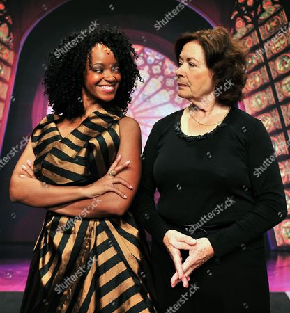 Stock Image of Zodwa Selele Lead Actress in the Musical 'Sister Act' in the Role of Deloris Van Cartier Poses with Karin Schroeder (r in the Role of Mother Superior) During the Presentation of Lead Actors at the Apollo Theater in Stuttgart Germany 23 October 2012 the Broadway Musical Premieres on 09 December 2012 Germany Stuttgart