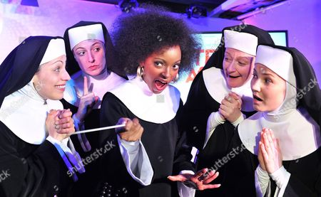 Lead Actress in the Musical Sister Act Zodwa Selele (c) As Deloris Van Cartier Poses with Actresses Sandra Bleicher (l-r) Natascha Jill Sabine Schreitmiller and Tanja Schoen As the Nun Ensemble During a Press Event in Stuttgart Germany 20 March 2012 the Musical Will Run From 09 December in the Apollo Theater in Stuttgart Germany Stuttgart