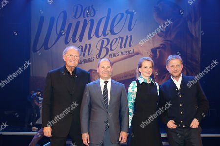 Stock Image of (l-r) Dutch Joop Van Den Ende Owner of Stage Entertainment International German Olaf Scholz Mayor of Hamburg Uschi Neuss Manager of Stage Entertainment Germany and German Film Director Soenke Wortmann Pose During a Press Conference For the New 'Theater an Der Elbe' by Stage Entertainment in Hamburg ágermany 30 January 2014 the Stage Musical Theater Will Open in November 2014 with the Play 'The Miracle Ofábern' About the Final Match of the 1954 Soccer World Cup in Bern Switzerland Germany Hamburg