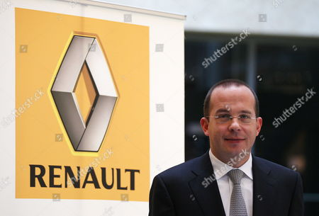 Stock Photo of Achim Schaible Ceo of Renault Deutschland (germany) Ag Poses For a Photograph Next to the French Car Maker Company's Logo in Duesseldorf Germany 05 January 2012 Renault Deutschland Ag on 05 January 2012 Announced Its Sales Figures For the Past Year 2011 Germany Duesseldorf