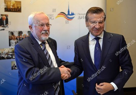 Chairpersons of the Petersburg Dialogue Lothar De Maiziere (l) For Germany and Viktor Zubkov For Russia Shake Hands During a Press Conference on the State of Preparations For the 13th Petersburg Dialogue in Leipzig Germany 21 October 2013 the Next German-russian Discussion Forum For the Promotion of Cooperation Between the Two Societies Will Take Place in Germany in December 2013 Germany Leipzig