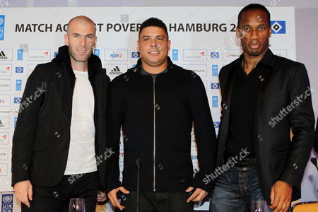 Former National Soccer Team Players (l-r) Zinedine Zidane of France Ronaldo Luis Nazario De Lima of Brazil and Didier Drogba of Ivory Coast Pose During a Press Conference in Hamburg Germany 13 December 2011 a Selection of Former Internationol Soccer Pros Are Playing Hamburger Sv in the Benefit Match 'Match Against Poverty' at Imtech Arena in Hamburg Germany Hamburg