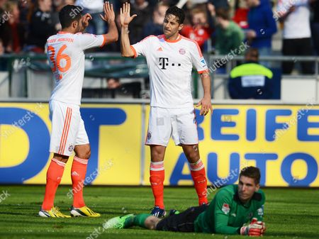 Munich's Claudio Pizarro (c) Celebrates with His Teammate Emre Can (l) After Scoring the 6-1 Lead Against Hanover's Goalkeeper Ron-robert Zieler (bottom) During the German Bundesliga Soccer Match Between Hanover 96 and Bayern Munich in Hanover Germany 20 April 2013 (attention: Embargo Conditions! the Dfl Permits the Further Utilisation of Up to 15 Pictures Only (no Sequential Pictures Or Video-similar Series of Pictures Allowed) Via the Internet and Online Media During the Match (including Halftime) Taken From Inside the Stadium And/or Prior to the Start of the Match the Dfl Permits the Unrestricted Transmission of Digitised Recordings During the Match Exclusively For Internal Editorial Processing Only (e G Via Picture Databases) Germany Hanover