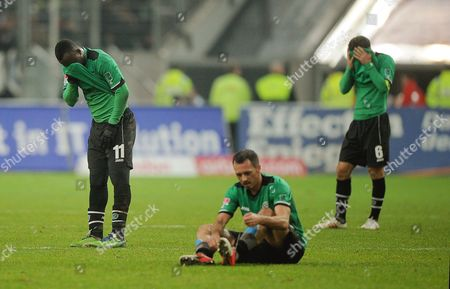 Hanover Players (l-r) Didier Ya Konan Sergio Pinto and Steven Cherundolo Show Their Dejection After the German Bundesliga Soccer Match Between Fortuna Duesseldorf and Hanover 96 in Duesseldorf Germany 15 December 2012 Duesseldorf Won 2-1 (attention: Embargo Conditions! the Dfl Permits the Further Utilisation of Up to 15 Pictures Only (no Sequential Pictures Or Video-similar Series of Pictures Allowed) Via the Internet and Online Media During the Match (including Halftime) Taken From Inside the Stadium And/or Prior to the Start of the Match the Dfl Permits the Unrestricted Transmission of Digitised Recordings During the Match Exclusively For Internal Editorial Processing Only (e G Via Picture Databases) Germany Duesseldorf
