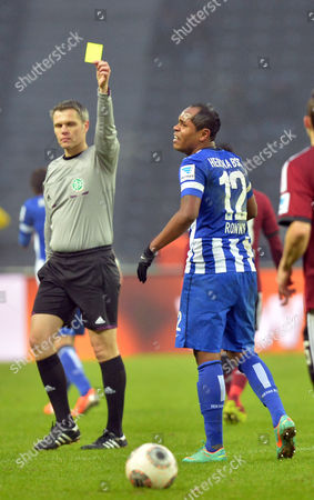 Referee Michael Weiner (l) Shows Hertha's Ronny the Yellow Card During the Bundesliga Soccer Match Between Hertha Bsc and 1 Fc Nuernberg at the Olympic Stadion in Berlin Germany 02 February 2014 Germany Berlin