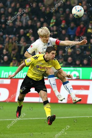 Dortmund's Robert Lewandowski (front) Vies For the Ball with Hoffenheim's Andreas Beck (back) During the German Bundesliga Soccer Match Between Borussia Dortmund and 1899 Hoffenheim in Dortmund Germany 28 January 2012 (attention: Embargo Conditions! the Dfl Permits the Further Utilisation of the Pictures in Iptv Mobile Services and Other New Technologies Only No Earlier Than Two Hours After the End of the Match the Publication and Further Utilisation in the Internet During the Match is Restricted to 15 Pictures Per Match Only ) Germany Dortmund