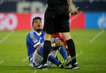Schalke's Kevin-prince Boateng Sits on the Pitch Below Referee Michael Weiner During the German Bundesliga Match Between Fc Schalke 04 and Vfb Stuttgart at Veltins Arena in Gelsenkirchen ágermany 30ánovember 2013 (attention: Due to the Accreditation Guidelines the Dfl Only Permits the Publication and Utilisation of Up to 15 Pictures Per Match on the Internet and in Online Media During the Match ) Germany Gelsenkirchen