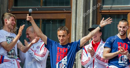 Playres of Bundesliga Soccer Club Fc Bayernámunich Thomas Mueller (l-r) Arjen Robben Rafinha Pierre-emile Hojbjerg and Diego Contento Celebrate Their Dfb Cup Title on the Balcony of the City Hall in Munich Germany 18 May 2014 Munich Won the Final of the Dfb Cup in Against Borussia Dortmund 2-0 Germany Munich