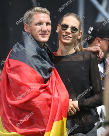 Bastian Schweinstieger and His Girlfriend Sarah Brandner Stand Nextto Each Other During the Reception of the German National Team in Berlin Germany 15 July 2014 the German Team on 13 July 2014 Had Won the Brazil 2014 Fifa Soccer World Cup Final Against Argentina by 1-0 to Win the Title For the Fourth Time After 1954 1974 and 1990 Germany Berlin