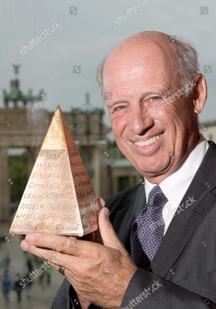 German Entrepreneur Willy Bogner Poses with the Golden Sport Pyramid at the Hotel Adlon in Berlin Germany 31 May 2013 the Fashion Designer and Former Alpine Skier Will Be Awarded with the Golden Sport Pyramid This Evening Bogner Also Will Be Inducted Into the German Sports Hall of Fame Germany Berlin