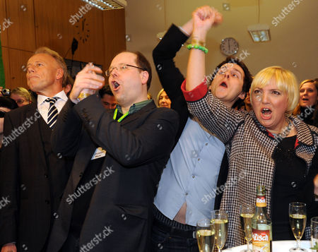 Chairmen of the German Party the Greens Claudia Roth and Juergen Trittin (l) Cheer with Christian Meyer (2-l) and Sven Kindler in Reaction to Preliminary Results of the Lower Saxony State Elections in Hanover Germany 20 January 2013 Some 6 1 Million Eligible Voters Were Casting Ballots 20 January in the Key German State of Lower Saxony with the Race Neck-and-neck Between the Ruling Coalition of German Chancellor Angela Merkel and the Centre-left Opposition the Election in the State That is Home to Volkswagen and Many Small Industries is Seen As a Test of the German General Election Expected in September Germany Hanover
