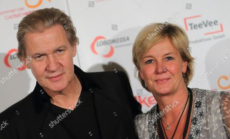 Irish Singer Johnny Logan (l) and His Girlfriend and Manager Tanja Surmann Arrive For the After Show Party of the German Television Live Broadcast Music Show 'Welcome at Carmen Nebel' at the Getec-arena in Magdeburg Germany 26 October 2013 Germany Magdeburg