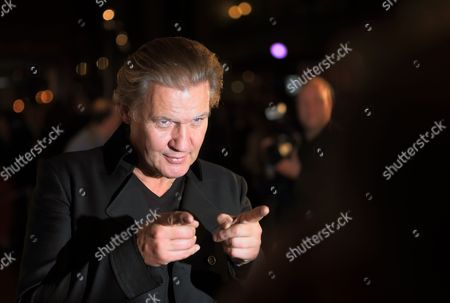 A Photo Made Available 27 October 2013 Shows Irish Singer Johnny Logan Arriving For the German Television Live Broadcast Music Show 'Willkommen Bei Carmen Nebel' (welcome at Carmen Nebel) at the Getec-arena in Magdeburg Germany 26 October 2013 Germany Magdeburg