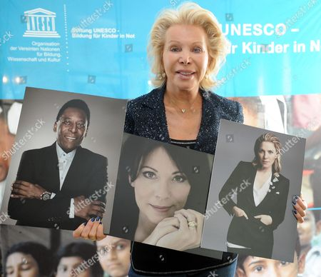 Unesco Ambassador Ute-henriette Ohoven at the Press Conference For the 21st Unesco Charity Gala with Pictures of Prominent Guests - Legendary Soccer Player Pele (l-r) Actress Iris Berben and Hollywood Star Kim Cattrall in Duesseldorf Germany 05 September 2012 the Unesco Gala with Many Celebrities Will Take Place in Duesseldorf on 27 September 2012 Germany Duesseldorf
