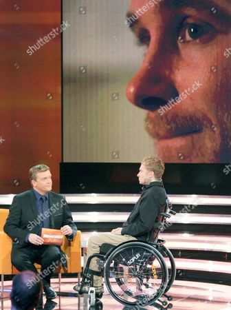 Stock Picture of Swiss Samuel Koch Speaks with German Television Host Hape Kerkeling During a Television Interview on a Zdf Program Looking Back at People 2011 in Munich Germany on 09 December 2011 Koch Has to Use a Wheelchair Following an Accident He Had While Trying Perfom a Stunt on the German Television Show 'Wetten Dass?' the Program Will Be Broardcast on 11 December 2011 Germany Munich