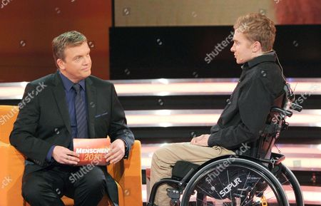 Swiss Samuel Koch Speaks with German Television Host Hape Kerkeling During a Television Interview on a Zdf Program Looking Back at People 2011 in Munich Germany on 09 December 2011 Koch Has to Use a Wheelchair Following an Accident He Had While Trying Perfom a Stunt on the German Television Show 'Wetten Dass?' the Program Will Be Broardcast on 11 December 2011 Germany Munich
