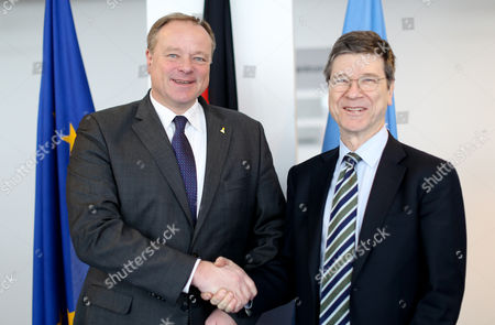 German Minister of Economic Cooperation and Development Dirk Niebel (l) Shakes Hands with Us Economist Jeffrey Sachs (r) at the Federal Ministry For Economic Cooperation and Development in Berlin Germany 19 March 2013 Sachs Supports Debt Relief For Extremely Poor Countries and Comes Through For Aid and Actions Against Sicknesses in Developing Countries Photo: Kay Nietfeld Germany Berlin