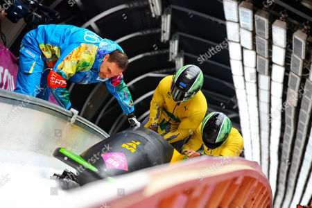 Winston Watts and Marvin Dixon of Jamaica After the Second Run of the Two-man Bobsleigh Competition at the Sanki Sliding Center at the Sochi 2014 Olympic Games Krasnaya Polyana Russia 16 February 2014 Russian Federation Krasnaya Polyana