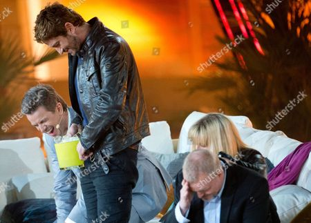 Stock Image of German Tv Host Markus Lanz (l) Swiss Model and Tv Personality Michelle Hunziker (2-r) and German Entertainer Stefan Raab (r) Look on As Scottish Actor Gerard Butler Empties a the Icecubes Into This Trousers on Stage at the Coliseo Balear Bull Fighting Arena 08 June 2013 During the Popular German Zdf Tv Channel Entertainment Show 'Wetten Dass ?' (bet That ') in Palma De Mallorca Mallorca Island Spain Butler Lost a Bet Spain Palma De Mallorca