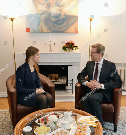 German Foreign Minister Guido Westerwelle (r) Meets with Yevhenia Tymoshenko Daughter of Julia Tymoshenko in Kiev Ukraine 11 October 2013 One of the Topics They Discussed was the Release of Former Ukrainian Prime Minister Julia Tymoshenko who is Serving a Seven Year Prison Sentence For Abuse of Power During Her Rule Ukraine Kiev