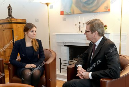 Stock Image of German Foreign Minister Guido Westerwelle (r) Meets with Yevhenia Tymoshenko Daughter of Julia Tymoshenko in Kiev Ukraine 11 October 2013 One of the Topics They Discussed was the Release of Former Ukrainian Prime Minister Julia Tymoshenko who is Serving a Seven Year Prison Sentence For Abuse of Power During Her Rule Ukraine Kiev