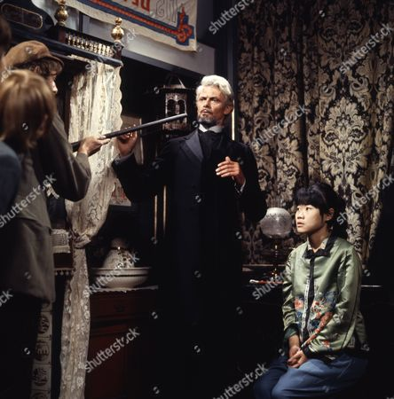 Victor Winding (as Barnaby Sweet) and Pik Sen Lim (as Su Ling), with Philip Maskery (as David Stilgoe) and cast member