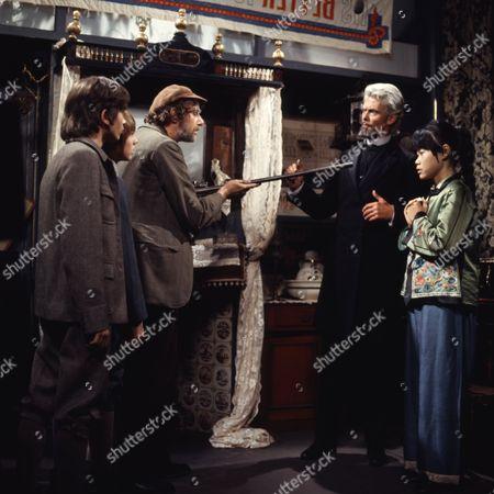 Victor Winding (as Barnaby Sweet) and Pik Sen Lim (as Su Ling), with (Dai) David Bradley (as Peter Weekes) and Philip Maskery (as David Stilgoe) & cast member