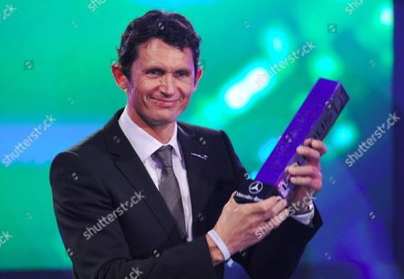 German Cyclist Michael Teuber Holds His Award at the Laureus Media Prize Event in Kitzbuehel Austria 14 November 2011 As a Result of a Car Crash in 1987 Michael Teuber Became Semi-paraplegic Since 1998 He Has Competed Successfully in Cycle Races Four Times Being Nominated For the Laureus Disability Award the Prizes Are Awarded For Journalistic Contributions Initiatives and People who Have Demonstrated a Special Social Engagement with Sport Austria Kitzbuehel