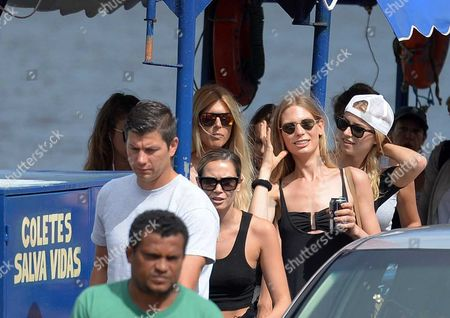 Mandy Grace Capristo (center L-r) Girlfriend of Germany's Soccer Player Mesut Oezil Sarah Brandner Girlfriend of Germany's Bastian Schweinsteiger and Lena Gercke Girlfriend of Sami Khedira Leave a Ferry with an Unidentified Man in Santo Andre Brazil 9 July 2014 the Fifa World Cup 2014 Takes Place in Brazil From 12 June to 13 July 2014 Brazil Santo Andre
