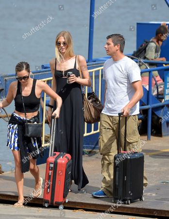Mandy Grace Capristo (l) Girlfriend of Germany's Soccer Player Mesut Oezil and Sarah Brandner (2-l) Girlfriend of Germany's Bastian Schweinsteiger Leave a Ferry with an Unidentified Man in Santo Andre Brazil 9 July 2014 the Fifa World Cup 2014 Takes Place in Brazil From 12 June to 13 July 2014 Brazil Santo Andre