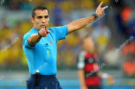 Referee Marco Rodriguez of Mexico Gestures During the Fifa World Cup 2014 Semi Final Match Between Brazil and Germany at the Estadio Mineirao in Belo Horizonte Brazil 08 July 2014 (restrictions Apply: Editorial Use Only not Used in Association with Any Commercial Entity - Images Must not Be Used in Any Form of Alert Service Or Push Service of Any Kind Including Via Mobile Alert Services Downloads to Mobile Devices Or Mms Messaging - Images Must Appear As Still Images and Must not Emulate Match Action Video Footage - No Alteration is Made to and No Text Or Image is Superimposed Over Any Published Image Which: (a) Intentionally Obscures Or Removes a Sponsor Identification Image; Or (b) Adds Or Overlays the Commercial Identification of Any Third Party Which is not Officially Associated with the Fifa World Cup) Brazil Belo Horizonte