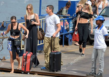 Mandy Grace Capristo (l) Girlfriend of Germany's Soccer Player Mesut Oezil Sarah Brandner (2-l) Girlfriend of Germany's Bastian Schweinsteiger and Lena Gercke (back R) Girlfriend of Germany's Sami Khedira Leave a Ferry in Santo Andre Brazil 9 July 2014 the Fifa World Cup 2014 Takes Place in Brazil From 12 June to 13 July 2014 Brazil Santo Andre