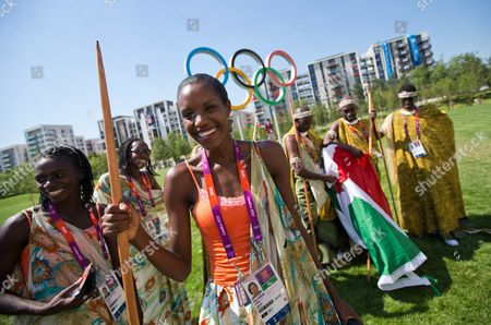 Stock Image of Diane Nukuri (c) of Burundi Poses in Front of the Olympic Rings at the Olympic Village in London Britain 24 July 2012 London Will Host the 2012 Olympic Games From 27 July 2012 to 12 August 2012 United Kingdom London