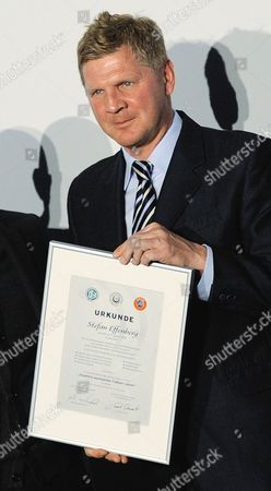 Former German National Player Stefan Effenberg Holds His Soccer Coach Certificate in His Hands in Bonn Germany 22 March 2012 a Total of 23 Participants Completed the 58th Soccer Coach Course at the Hennes Weisweiler Academy of the Dfb Germany Bonn