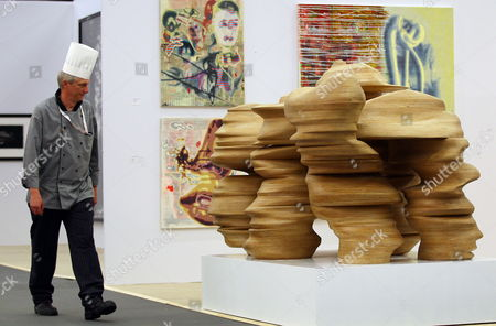 A Cook Walks Past the Work 'Round the Block' by British Artist Tony Cragg at the Booth of Hans Mayer at Art Cologne in Cologne Germany 17 April 2012 the Art Cologne Fair Will Open From 18 to 22 April Germany Cologne